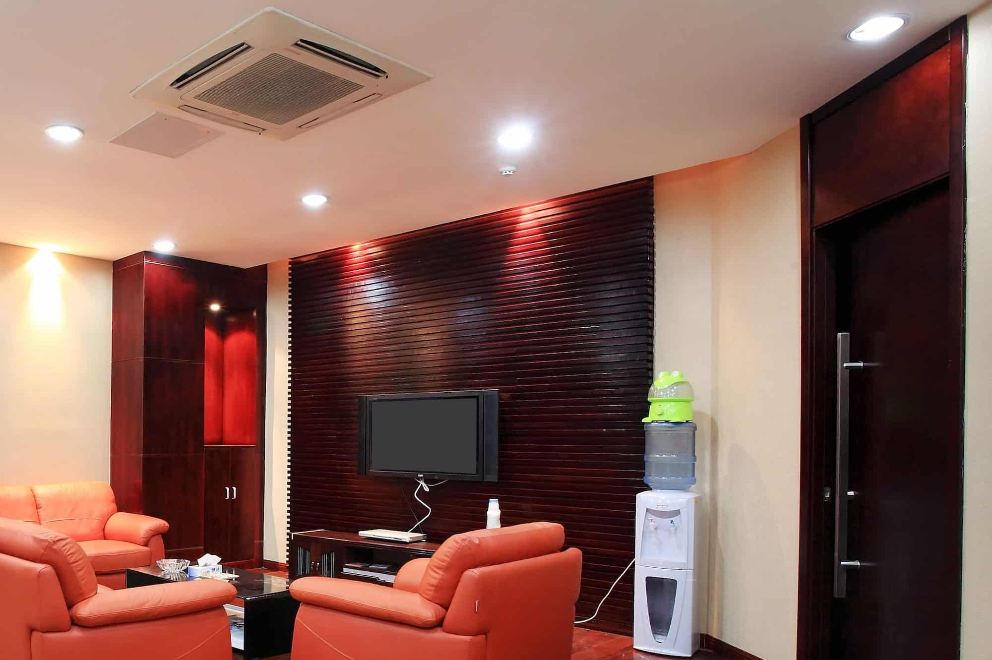 Multi-split air conditioning system in a residential living room with a red interior