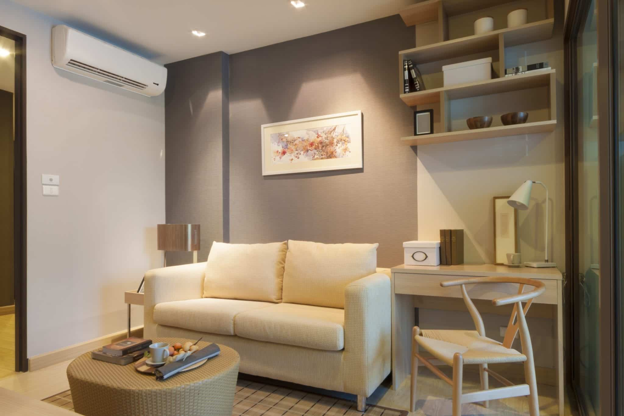 Single split air conditioner in residential living room with a beige interior design